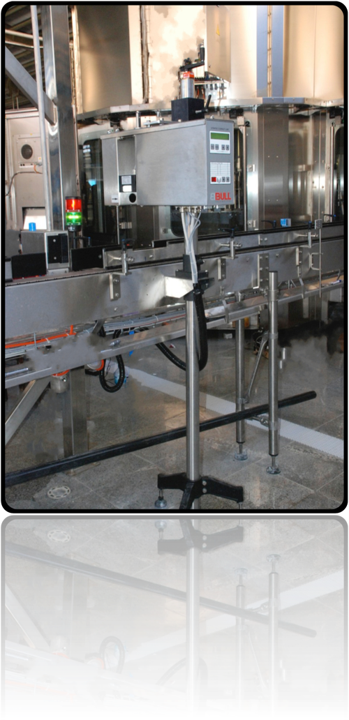 one of the cheapest, simplest, reliable and most successful X-rays Electronic Inspectors of the World, the model Compact Line-X by Stratec™,  BBULL™ Company.   Image shot in a Mineral Water Bottling Plant in the region of Shiraz, Iran.