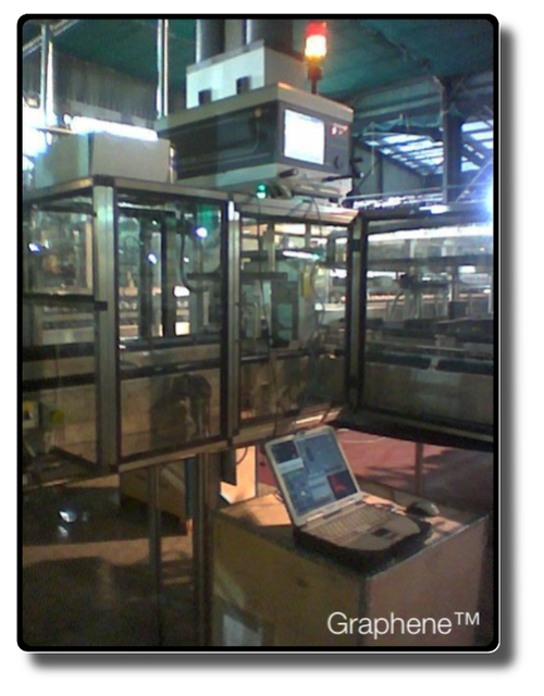 front view of a BS Norms-compliant Lexan cabinet completely embedding an Electronic Inspector controlling by mean of X-rays the filling level of cans.   It lies in the second largest AB-InBev™ Brewery in the United Kingdom, at Samlesbury, Lancashire, a Brewery producing 2.5 million hectolitres per year.  Part of these hectolitres canned in < 1700000 cans-per-day passing thru the X-rays inspection bridge visible above.