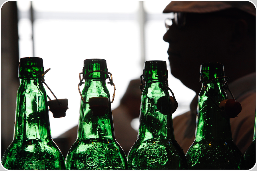 The most complete Glass Returnable Empty Bottle Inspectors of the World double-check the colour of each one bottle in the best metrologic conditions only met only after the Bottle Washer Machine (image credit GROLSCH®, 2013, a SABMiller company)