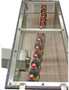 ultrasonic fobbing was born for multi lane conveyors like the one in this image. It can also be applied to common single-lanes in the filler outfeed, if the conveyor is tilted around 10º, to guarantee the same full contact with the left side guide and ultrasound transducer